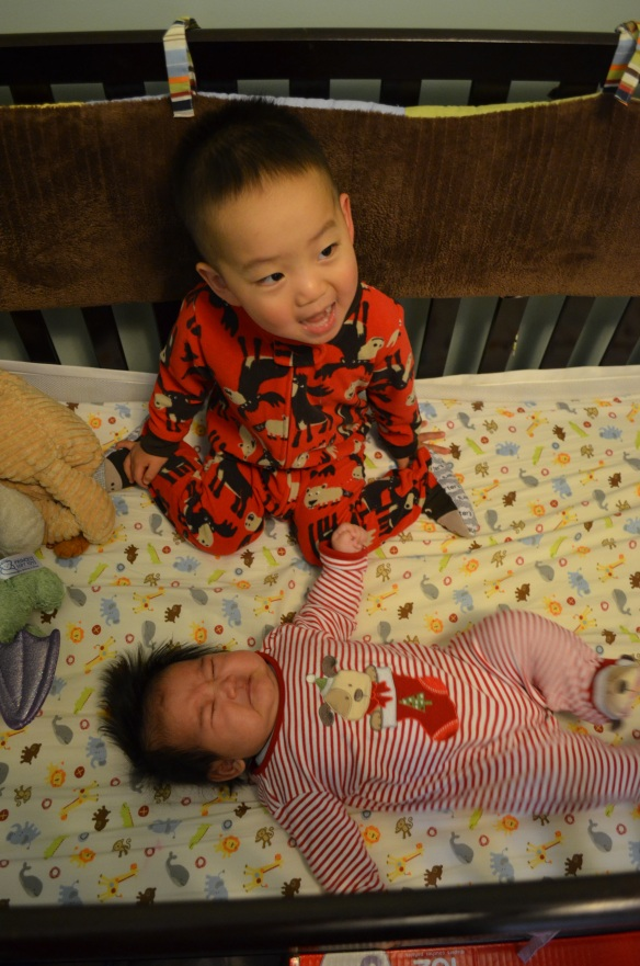 December 2012 - EZ just over 2 months old in his Christmas pj's handed down from his not-so-big Big Bro