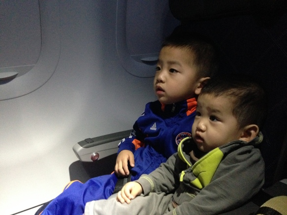 During the whole flight, I wanted to raise my hands in Halleluyer!   We had made it!  These morsels didn't know how much I worried about being able to flee.  They just knew that there was a small tv in front of them.